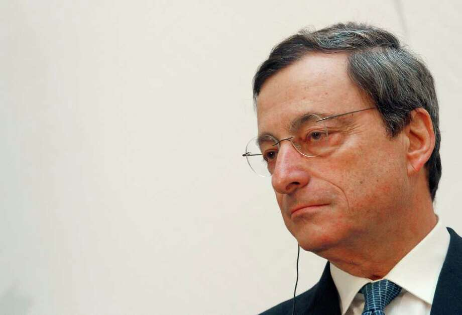 """Mario Draghi, president of the European Central Bank (ECB), listens during  the 'Ludwig Erhard Lecture' event in Berlin, Germany, on Thursday, Dec. 15, 2011. Draghi said there is no """"external savior"""" for countries that don't implement structural reforms to restore confidence to debt markets. Photographer: Michele Tantussi/Bloomberg *** Local Caption *** Mario Draghi Photo: Michele Tantussi / © 2011 Bloomberg Finance LP"""