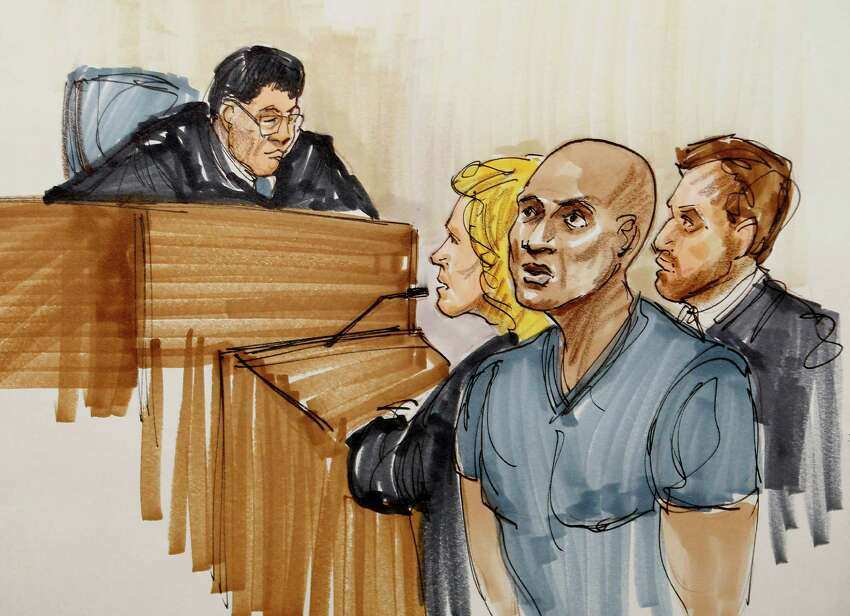 A courtroom artist's illustration portrays Sam Hurd (center, right) as he makes an initial appearance before U.S. Magistrate Young Kim (left) on drug charges.