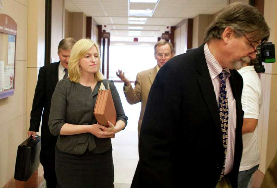 Prosecuting attorney Rachel Palmer walks out of the 185th District courtroom with the rest of her team Thursday. Palmer pleaded the Fifth Amendment when she was  subpoenaed to testify about evidence gathered by HPD's breath alcohol testing vehicles. Photo: Nick De La Torre / © 2011  Houston Chronicle