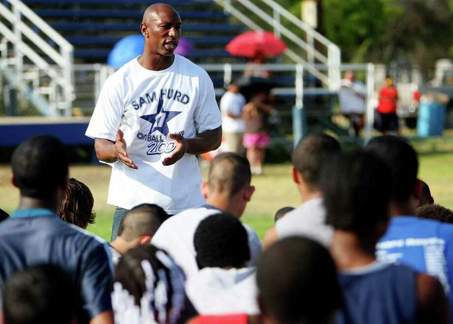 In this 2009 photo, wide receiver Sam Hurd talks to children attending Sam Hurd's Y football camp at St. Gerard High School. Photo: EDWARD A. ORNELAS, SAN ANTONIO EXPRESS-NEWS / eaornelas@express-news.net