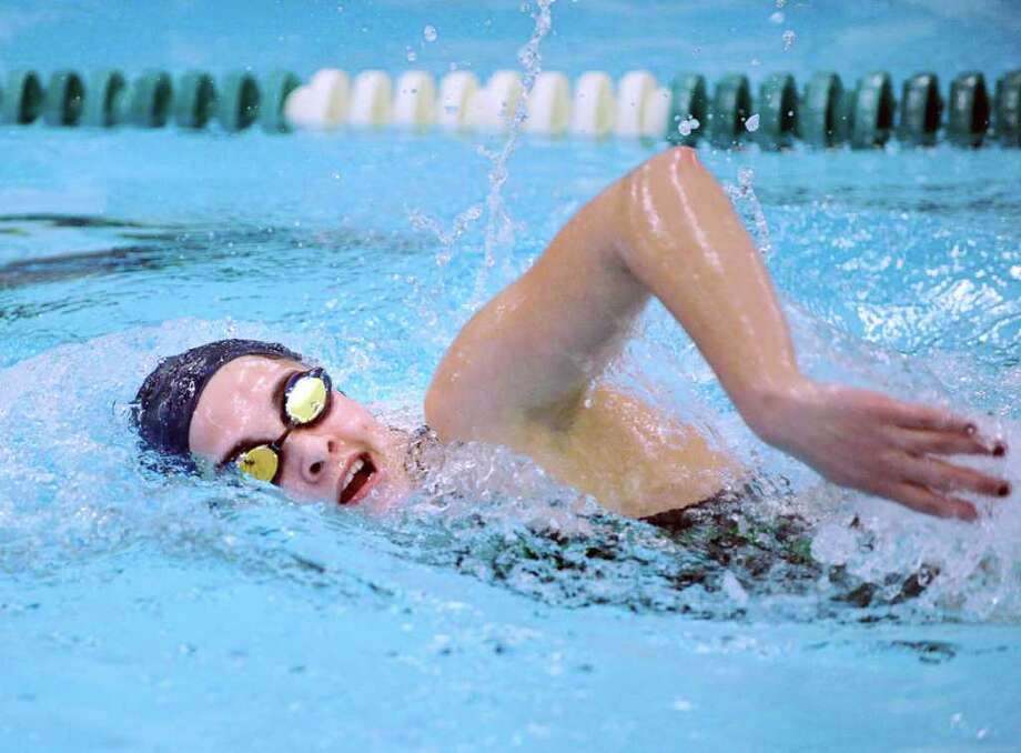 Nicole Rogers of Convent of the Sacred Heart swims the freestyle leg in the 200 IM event during swim meet between Convent of the Sacred Heart and Ethel Walker School at Convent of the Sacred Heart in Greenwich, Wednesday afternoon, Jan. 11, 2012. Photo: Bob Luckey / Greenwich Time
