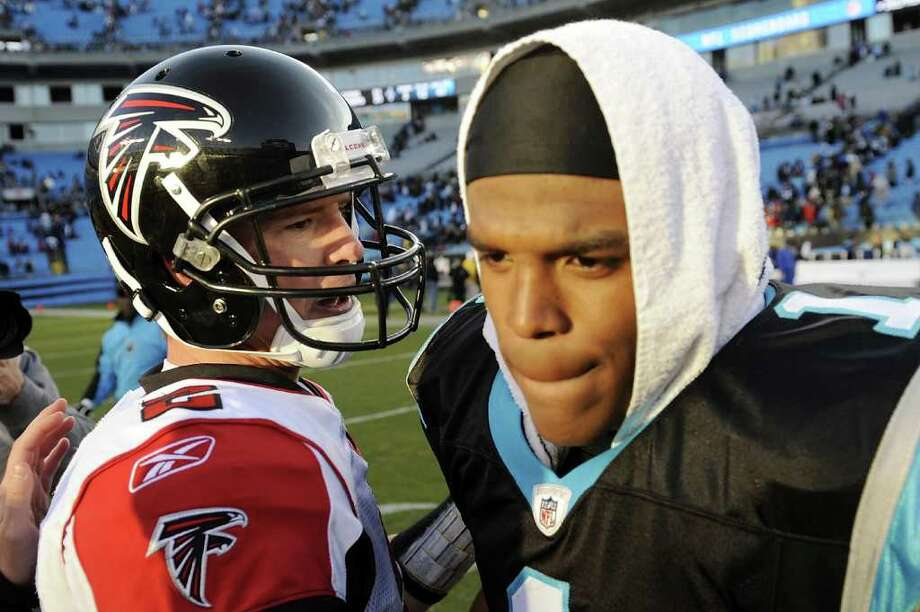 CHARLOTTE, NC - DECEMBER 11:  Quarterbacks Matt Ryan #2 of the Atlanta Falcons and Cam Newton #1 of the Carolina Panthers shake hands following the game at Bank of America Stadium on December 11, 2011 in Charlotte, North Carolina.  (Photo by Jared C. Tilton/Getty Images) Photo: Jared C. Tilton / 2011 Getty Images