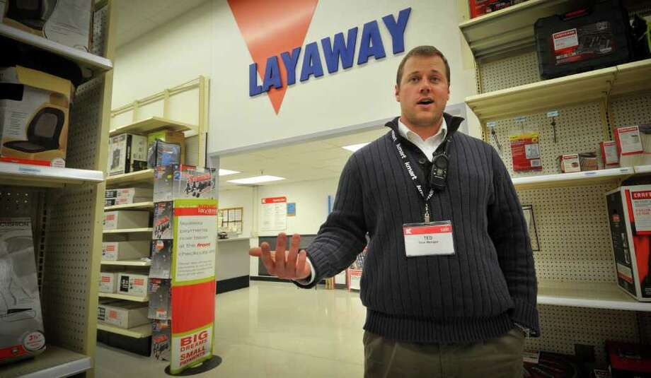 Kmart store manager Ted Straub talks Thursday Dec 15, 2011 in his  Omaha, Neb store. Dozens of Kmart customers across the country have had their layaways paid off by strangers. (AP Photo/Dave Weaver) Photo: Dave Weaver