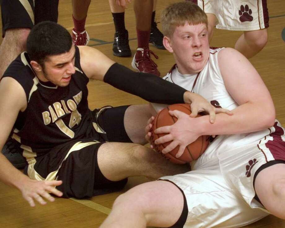 Joel Barlow's Steven Michos tries to grab the ball from Bethel's Ian Melvin during their Tip Off Classic game in the Danbury War Memorial at Rogers Park on Thursday, Dec. 15, 2011. Bethel won 54-35. Photo: Jason Rearick / The News-Times
