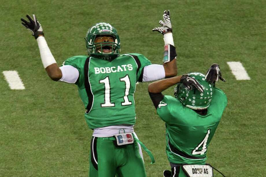 Hempstead defensive backs Trechel Momon (11) and Tribete Smith (40) celebrate after Smith intercepted a pass against Melissa during the first quarter of the 2A Div. I state championship high school football game at Cowboys Stadium Thursday, Dec. 15, 2011, in Arlington. Photo: Smiley N. Pool, Houston Chronicle / © 2011  Houston Chronicle
