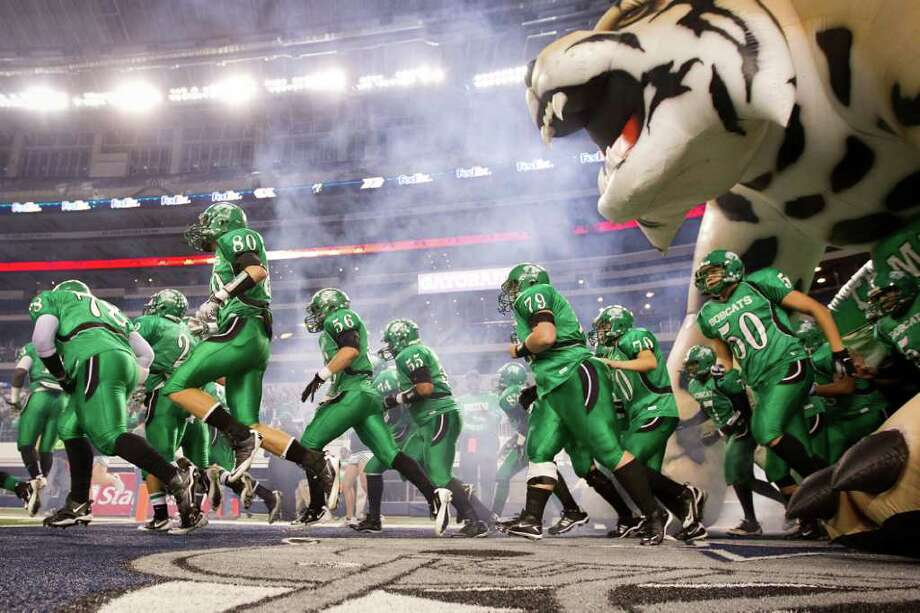 Hempstead players take the field before the 2A Div. I state championship high school football game at Cowboys Stadium Thursday, Dec. 15, 2011, in Arlington. Photo: Smiley N. Pool, Houston Chronicle / © 2011  Houston Chronicle