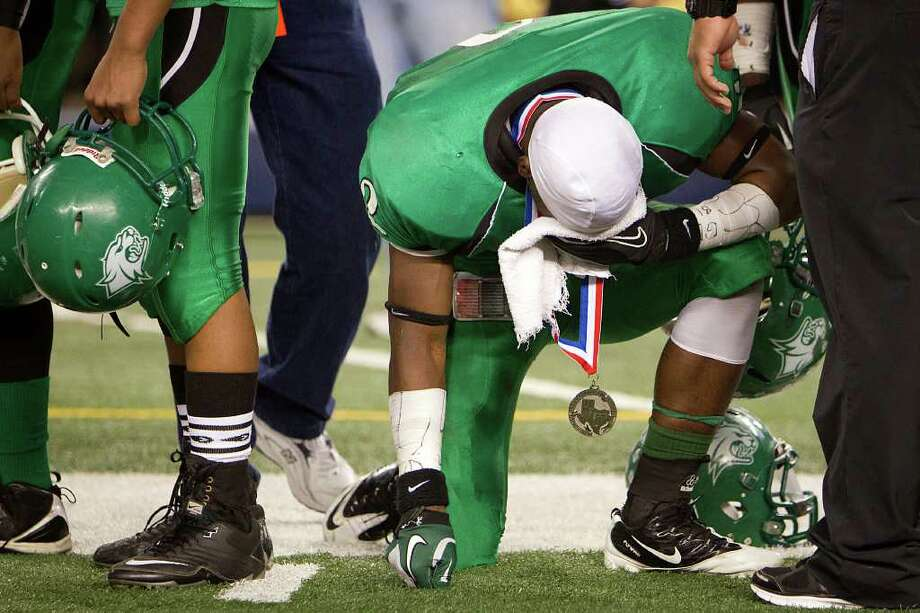 Hempstead's Michael Wolfe (2) reacts after being awarded the state second place medal after a loss to Melissia in the 2A Div. I state championship high school football game at Cowboys Stadium Thursday, Dec. 15, 2011, in Arlington. Photo: Smiley N. Pool, Houston Chronicle / © 2011  Houston Chronicle