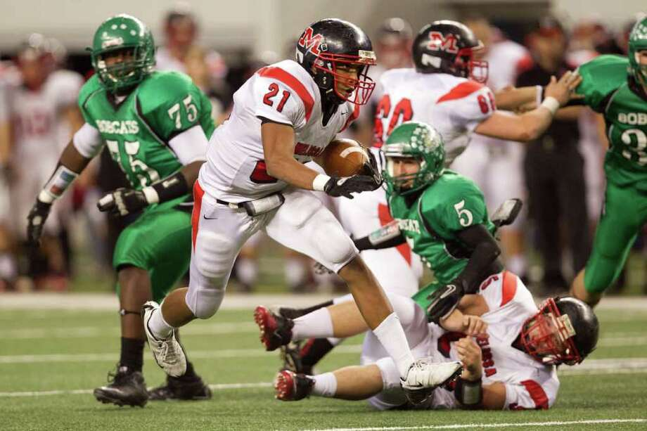 Melissa running back Kristov George (21) breaks through the Hempstead defense for a first down during the second half of the 2A Div. I state championship high school football game at Cowboys Stadium Thursday, Dec. 15, 2011, in Arlington. Photo: Smiley N. Pool, Houston Chronicle / © 2011  Houston Chronicle