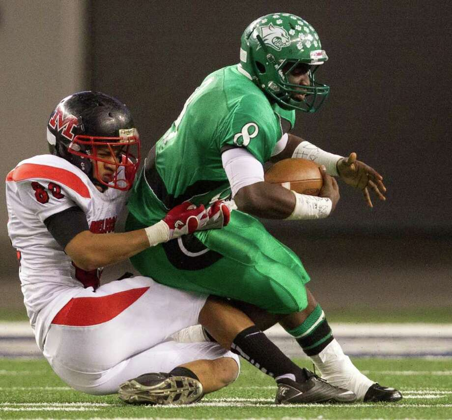 Hempstead quarterback Obie Wilder (8) is sacked by Melissa defensive back Xavier Mason (83) during the second half of the 2A Div. I state championship high school football game at Cowboys Stadium Thursday, Dec. 15, 2011, in Arlington. Photo: Smiley N. Pool, Houston Chronicle / © 2011  Houston Chronicle