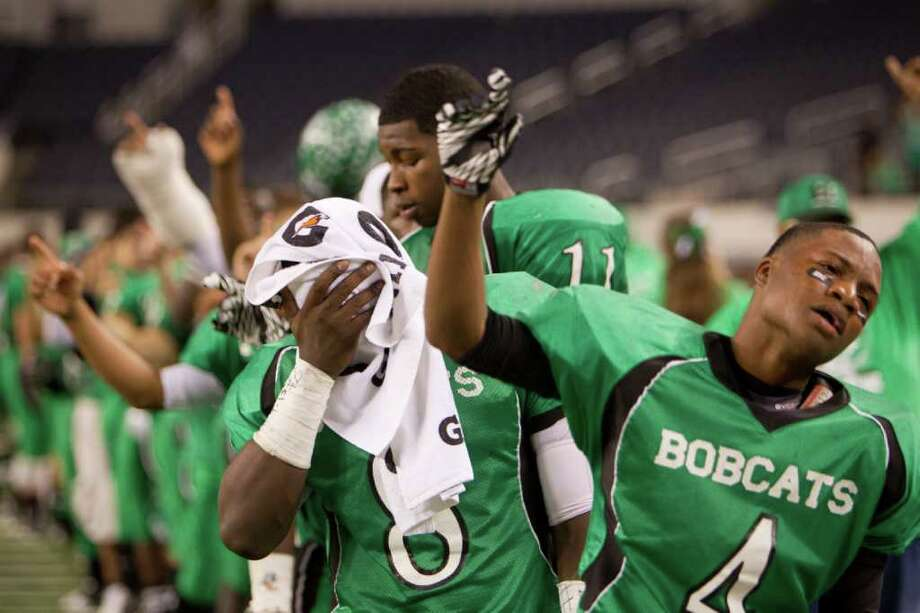 Hempstead's Obie Wilder (8) and Tribete Smith (4) stand for their team's school song after a loss to Melissa in the 2A Div. I state championship high school football game at Cowboys Stadium Thursday, Dec. 15, 2011, in Arlington. Photo: Smiley N. Pool, Houston Chronicle / © 2011  Houston Chronicle