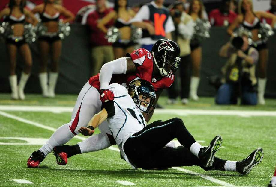 ATLANTA, GA - DECEMBER 15: Blaine Gabbert #11 of the Jacksonville Jaguars is pressured by Jonathan Babineaux #95 of the Atlanta Falcons at the Georgia Dome on December 15, 2011 in Atlanta, Georgia. (Photo by Scott Cunningham/Getty Images) Photo: Scott Cunningham / 2011 Getty Images