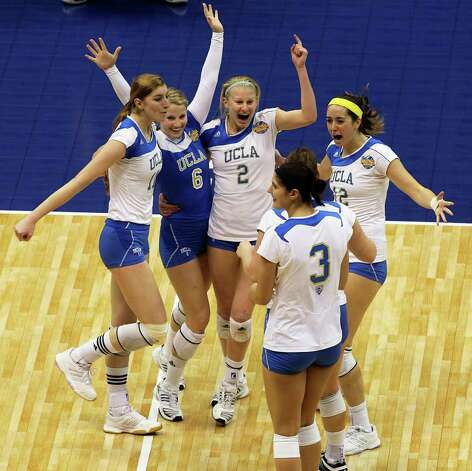 The Bruins celebrate a 3-0 victory as UCLA plays Florida State in a  2011 NCAA National Semifinal match at the Alamodome on December 15, 2011 Tom Reel/Staff Photo: TOM REEL, Express-News / © 2011 San Antonio Express-News