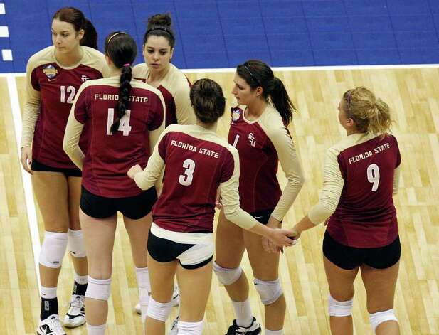 Florida State players react after their 2011 NCAA Division I Women's Volleyball National Semifinal Championship match with UCLA Thursday Dec. 15, 2011 at the Alamodome. UCLA defeated Florida State 25-16, 25-17, 25-21. PHOTO BY EDWARD A. ORNELAS/eaornelas@express-news.net) Photo: EDWARD A. ORNELAS, Express-News / © SAN ANTONIO EXPRESS-NEWS (NFS)