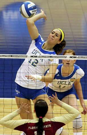 Mariana Aquino pounds a shot for the Bruins as UCLA plays Florida State in a  2011 NCAA National Semifinal match at the Alamodome on December 15, 2011 Tom Reel/Staff Photo: TOM REEL, Express-News / © 2011 San Antonio Express-News
