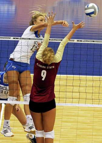 Zoe Nightingale slips the ball past the Seminoles' Visnja Djurdjevic as UCLA plays Florida State in a  2011 NCAA National Semifinal match at the Alamodome on December 15, 2011 Tom Reel/Staff Photo: TOM REEL, Express-News / © 2011 San Antonio Express-News