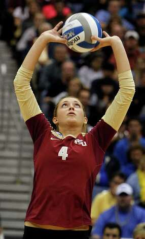 Florida State's Sarah Wickstrom sets the ball against UCLA during game action of the 2011 NCAA Division I Women's Volleyball Championship National Semifinal Match #1 at the Alamodome on Thursday, Dec. 15, 2011. MICHAEL MILLER / mmiller@express-news.net Photo: MICHAEL MILLER, Express-News / mmiller@express-news.net