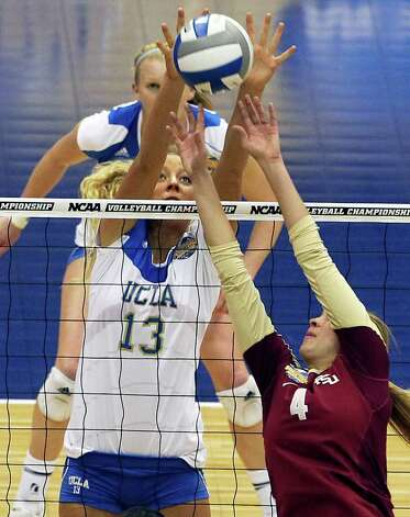 Zoe Nightingale blocks an attenpted dink by the Seminoles as UCLA plays Florida State in a  2011 NCAA National Semifinal match at the Alamodome on December 15, 2011 Tom Reel/Staff Photo: TOM REEL, Express-News / © 2011 San Antonio Express-News