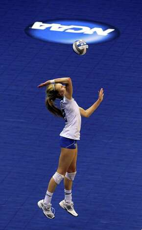 Kely Reeves serves a ball for the Bruins in the third set as UCLA plays Florida State in a  2011 NCAA National Semifinal match at the Alamodome on December 15, 2011 Tom Reel/Staff Photo: TOM REEL, Express-News / © 2011 San Antonio Express-News