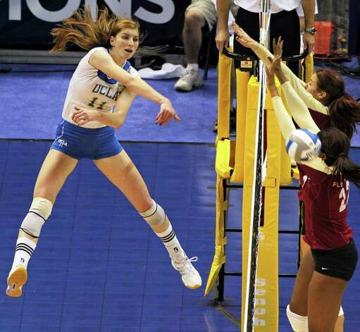 Rachael Kidder gets another kill for the Bruins as  UCLA plays Florida State in a  2011 NCAA National Semifinal match at the Alamodome on December 15, 2011 Tom Reel/Staff Photo: TOM REEL, Express-News / © 2011 San Antonio Express-News