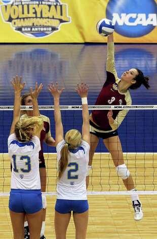 Jekaterina Stepanova slams a shot for the Seminoles as UCLA plays Florida State in a  2011 NCAA National Semifinal match at the Alamodome on December 15, 2011 Tom Reel/Staff Photo: TOM REEL, Express-News / © 2011 San Antonio Express-News