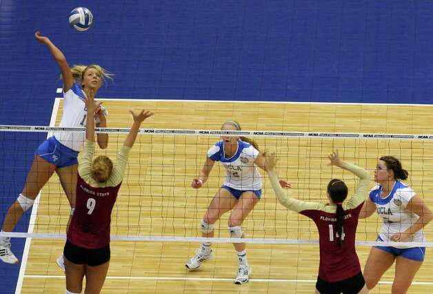 UCLA's Zoe Nightingale (13) goes for a kill against Florida State's Visnja Djurdjevic (9) during game action of the 2011 NCAA Division I Women's Volleyball Championship National Semifinal Match #1 at the Alamodome on Thursday, Dec. 15, 2011. UCLA defeated Florida State in straight sets, 25-16, 25-17, 25-21. MICHAEL MILLER / mmiller@express-news.net Photo: MICHAEL MILLER, Express-News / mmiller@express-news.net