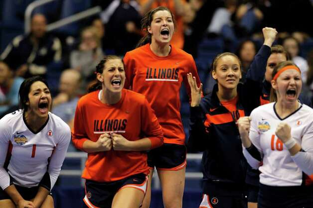 The Illinois bench cheers on their team after a point during game action of the 2011 NCAA Division I Women's Volleyball Championship National Semifinal Match #2 against USC at the Alamodome on Thursday, Dec. 15, 2011. Illinois defeated USC in five sets, 25-27, 25-18, 25-22, 18-25 and 15-10 in the tie breaker. MICHAEL MILLER / mmiller@express-news.net Photo: MICHAEL MILLER, Express-News / mmiller@express-news.net