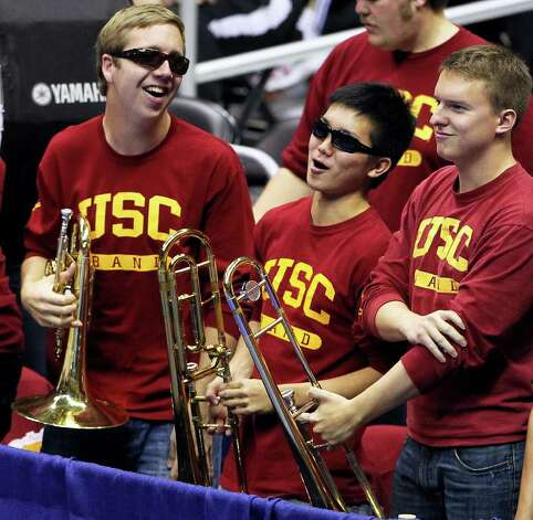 USC band members enjoy a timeout as Illinois plays USC  in a  2011 NCAA National Semifinal match at the Alamodome on December 15, 2011 Tom Reel/Staff Photo: TOM REEL, Express-News / © 2011 San Antonio Express-News
