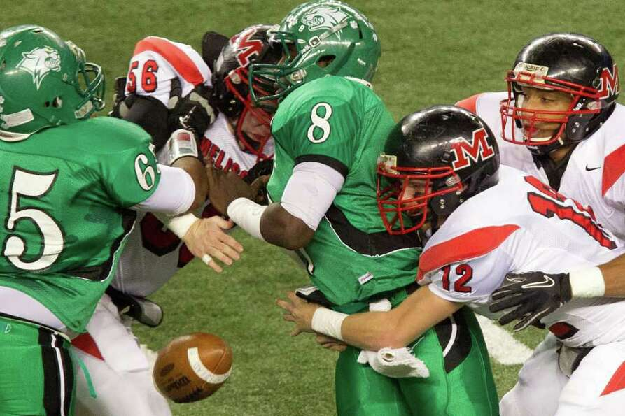 Hempstead quarterback Obie Wilder (8) fumbles the ball for a turnover as he is hit by Melissa lineba