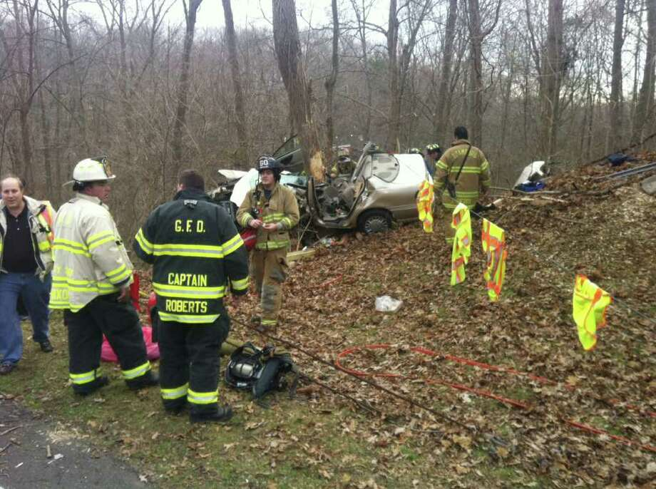 Greenwich firefighters and other emergency personnel at the scene of a serious accident near Den Road on the northbound side of the Merritt Parkway on Thursday, Dec. 15, 2011. A New Hampshire teen, Branden Myers, was killed in the crash. Photo: John Nickerson