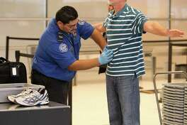 An airline passenger at San Antonio International Airport Terminal B receives a pat down from a Transportation Security Administration agent on Wednesday, Nov. 24, 2010. Traffic for the upcoming Thanksgiving holiday at the airport was about average according to officials at the airport. Kin Man Hui/kmhui@express-news.net
