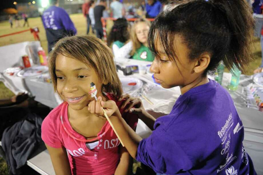 Tia Murray, 11, gets her face painted by Jurnee Jones, a sophomore from George Ranch High near Richmond, during Wonderland in Westchase at the Quillian Center on Thursday, Dec. 15. Photo: Thomas Nguyen, For The Chronicle / Freelance