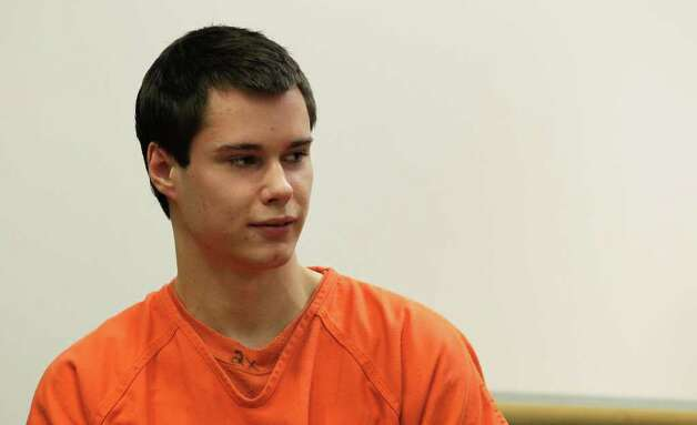 "Colton Harris-Moore, also known as the ""Barefoot Bandit,"" glances at the courtroom gallery as he walks to the defense table, in Island County Superior Court, Friday, Dec. 16, 2011, in Coupeville, Wash.  Harris-Moore pleaded guilty Friday to burglary and theft charges in the Barefoot Bandit case. The 20-year-old softly answered affirmatively when the judge asked if he understood his rights. He said guilty when the judge asked how he wanted to plead. Photo: AP"