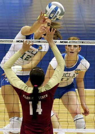SPORTS   Mariana Aquino slams for the Bruins as UCLA plays Florida State in a  2011 NCAA National Semifinal match at the Alamodome on December 15, 2011 Tom Reel/Staff Photo: TOM REEL, SAN ANTONIO EXPRESS-NEWS / © 2011 San Antonio Express-News