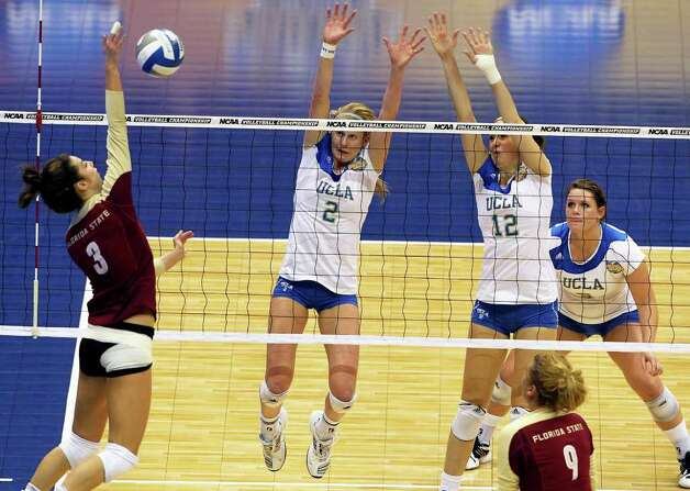 SPORTS   The Seminoles Jekaterina Stepanova hits into Bruin blockers as UCLA plays Florida State in a  2011 NCAA National Semifinal match at the Alamodome on December 15, 2011 Tom Reel/Staff Photo: TOM REEL, SAN ANTONIO EXPRESS-NEWS / © 2011 San Antonio Express-News