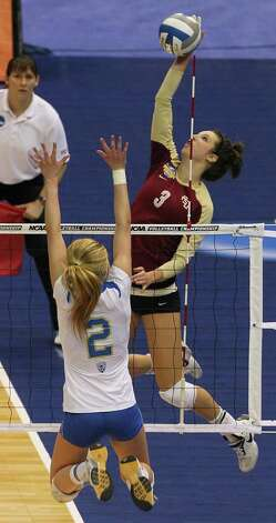 SPORTS   The Seminoles' Jekaterina Stepanova skies for a shot as UCLA plays Florida State in a  2011 NCAA National Semifinal match at the Alamodome on December 15, 2011 Tom Reel/Staff Photo: TOM REEL, SAN ANTONIO EXPRESS-NEWS / © 2011 San Antonio Express-News