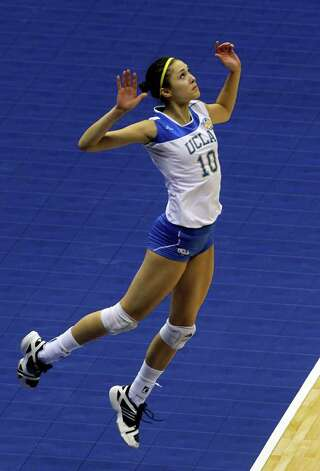SPORTS   Bojana Todorovic jumps to serve as UCLA plays Florida State in a  2011 NCAA National Semifinal match at the Alamodome on December 15, 2011 Tom Reel/Staff Photo: TOM REEL, SAN ANTONIO EXPRESS-NEWS / © 2011 San Antonio Express-News