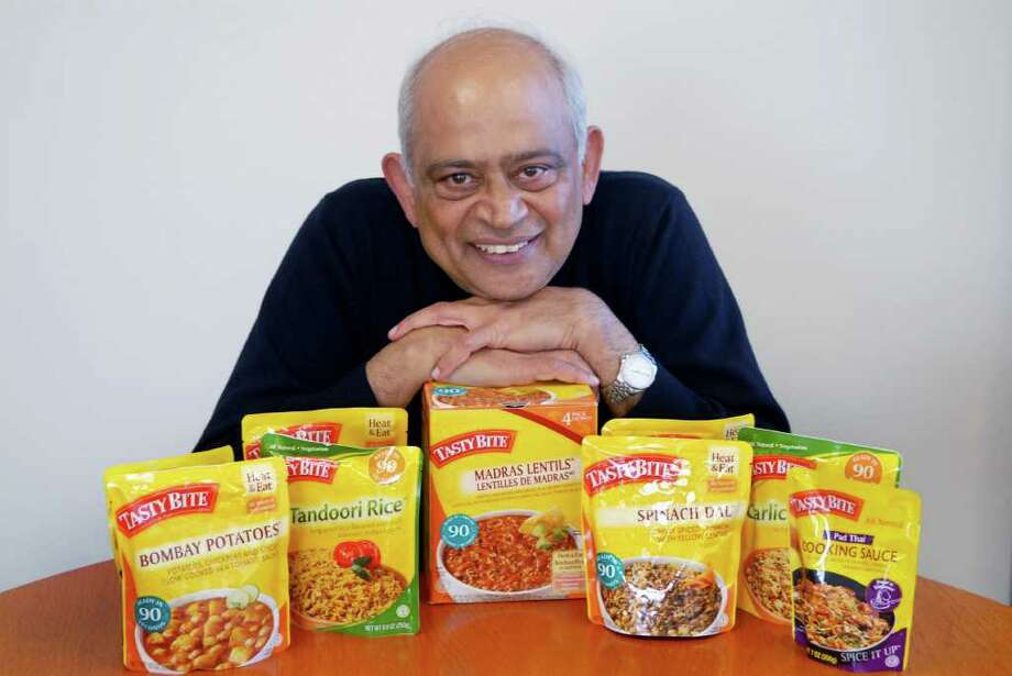Ashok Vasudevan, CEO of Preferred Brands International, with some of the products in his Stamford, Conn. office on Friday December 16, 2011. Photo: Dru Nadler / Stamford Advocate Freelance