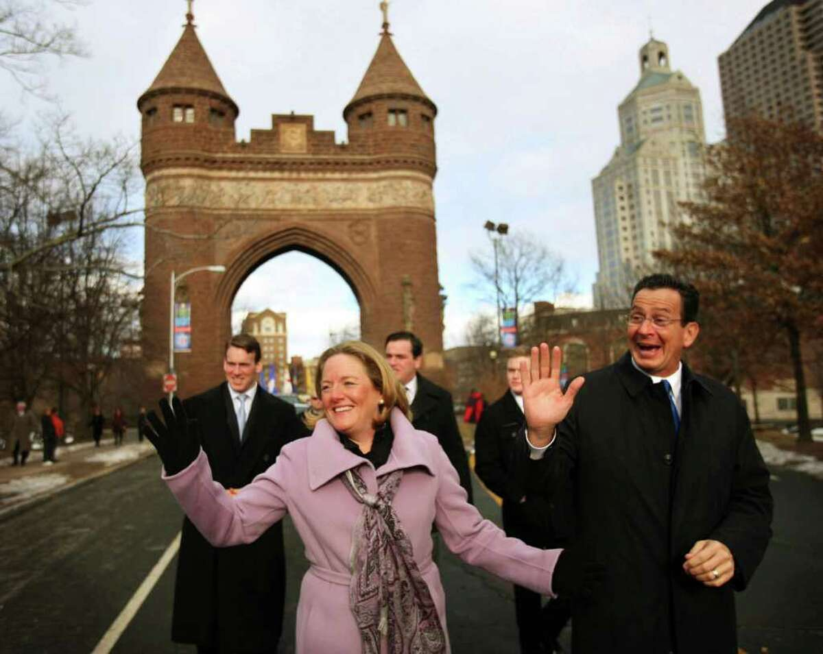 Connecticut Gov. Dan Malloy and his wife Cathy wave to supporters as they walk with their sons, Dan, Ben and Sam, in the inaugural parade in downtown Hartford on Wednesday, January 5, 2011. The tension between Malloy's high profile and his family's desire for privacy is central to his administration.