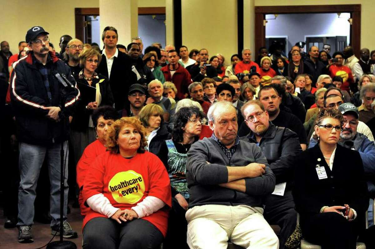 Connecticut citizens listen as Gov. Dan Malloy speaks during a town hall meeting in City Hall Annex in Bridgeport, Conn. Feb. 21, 2011. The meeting was the first of 17 Malloy has planned around the state. From the start, Malloy has argued to the public that his tax hikes and spending cuts were fair and balanced.