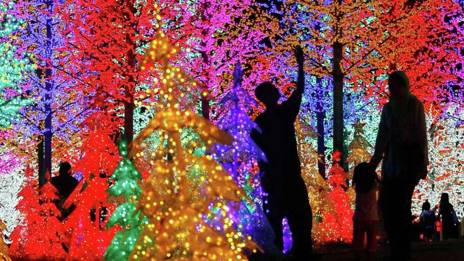 Malaysians admire light decorations ahead of Christmas in Shah Alam outside Kuala Lumpur, Malaysia. About 9.1 percent of Malaysia's total population is Christian. Photo: Syamsul Bahri Muhammad, Getty Images / 2010 Getty Images