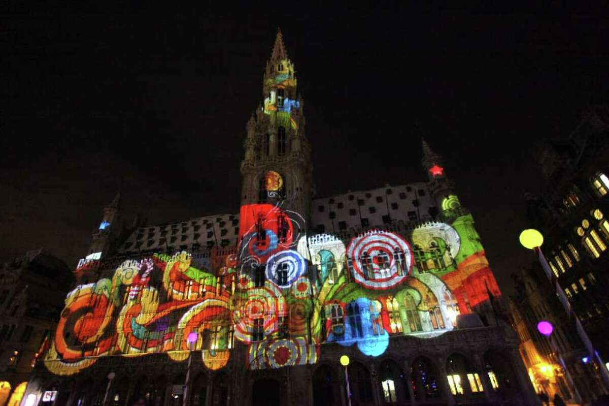 Christmas lights illuminate the Town Hall at La Grande Place in Brussels, Belgium.