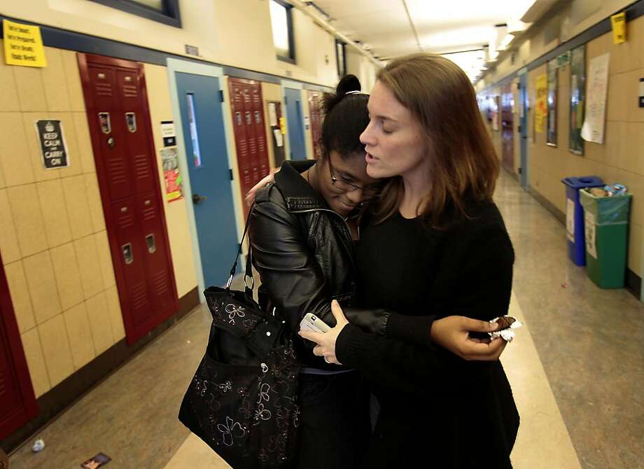 Student Iyahna Willingham (left) hugged Leadership executive director Elizabeth Rood as she was leaving the school for the semester. Leadership High School, a charter school, in San Francisco, Calif. has been cited for poor academic performance Thursday December 15, 2011, but supporters maintain that the school population is mostly minority students, who transferred with past educational difficulties. Many of the students go onto college. Photo: Brant Ward, The Chronicle