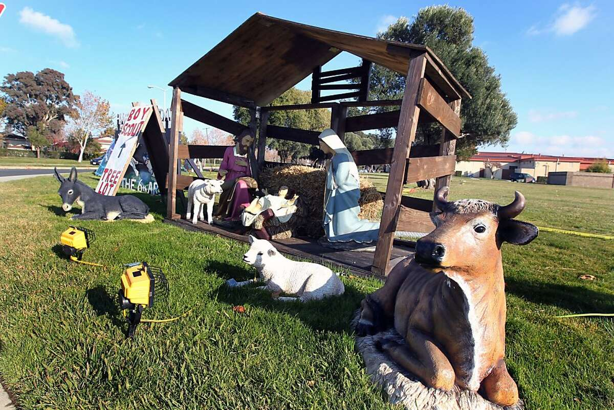 The nativity scene at the corners of Travis Ave and Skymaster Drive on Travis Air Force Base in Fairfield California has come under fire from an organization based in New Mexico. The military free-religion group claims the holiday decorations at the base's main intersection that include Santa?•s, reindeer -- and a nativity scene and a menorah, are unconstitutional promotion of a religion and asked that the overtly religious decorations be moved to the base's chapel nearby. Thursday December 15, 2011.