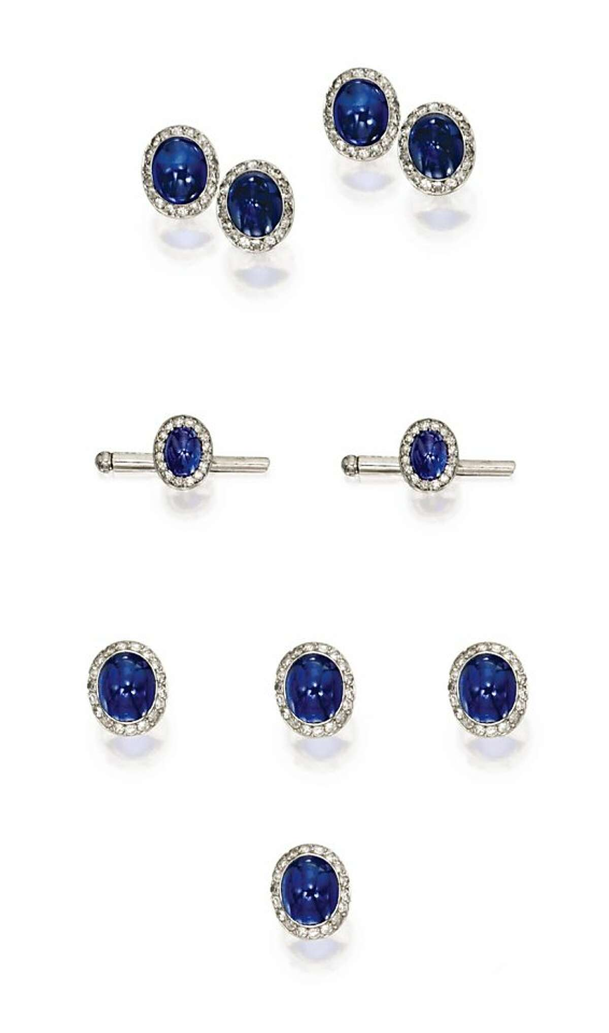 This platinum and cabochon sapphire and diamond dress set (cufflinks, tie pin) owned by the late John Traina was valued at $10,000 to $15,000 and sold at auction at Sothbey's in New York to an anonymous bidder for $182,500 on Dec. 7, 2011.