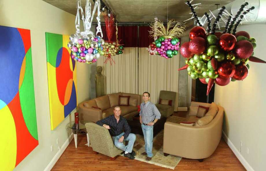 (For the Chronicle/Gary Fountain, December 9, 2011) Gregg Gebetsberger, left, and Anthony Villa in their home with the Christmas Ball Clusters Anthony created hanging from their ceiling. Photo: Gary Fountain / Copyright 2011 Gary Fountain