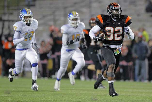 In this photo taken Friday, Dec. 9, 2011, Aledo running back Johnathan Gray takes off on a touchdown run in the third quarter against Corsicana Tigers in a Class 4A Division II semifinal high school football game in Mesquite, Texas. Gray was named the Texas Associated Press Sports Editors Player of the Year on Friday, Dec. 16, a day before he was to play his final prep game assured of being at least the second-most prolific running back in state history. Photo: AP