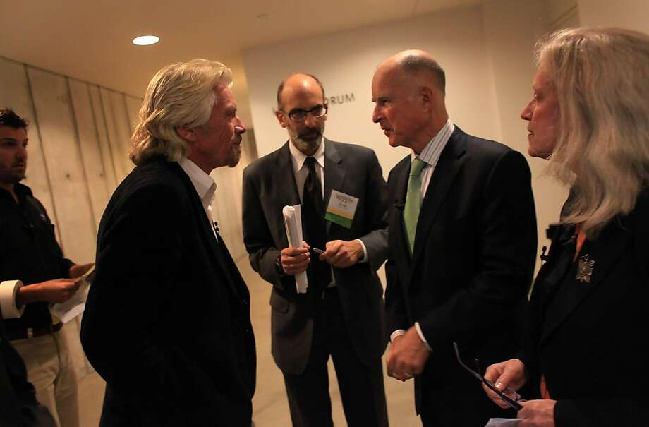 Sir Richard Branson (left) and California Governor Jerry Brown (second from right) talk before the start of The Governor's Conference on Extreme Climate Risks and California's Future at the California Academy of Sciences in Golden Gate Park on Thursday, December 15, 2011 in San Francisco, Calif. Photo: Lea Suzuki, The Chronicle