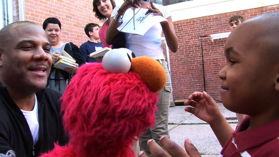 """Elmo and Kevin Clash in """"Being Elmo."""" Photo: Submarine Entertainment"""