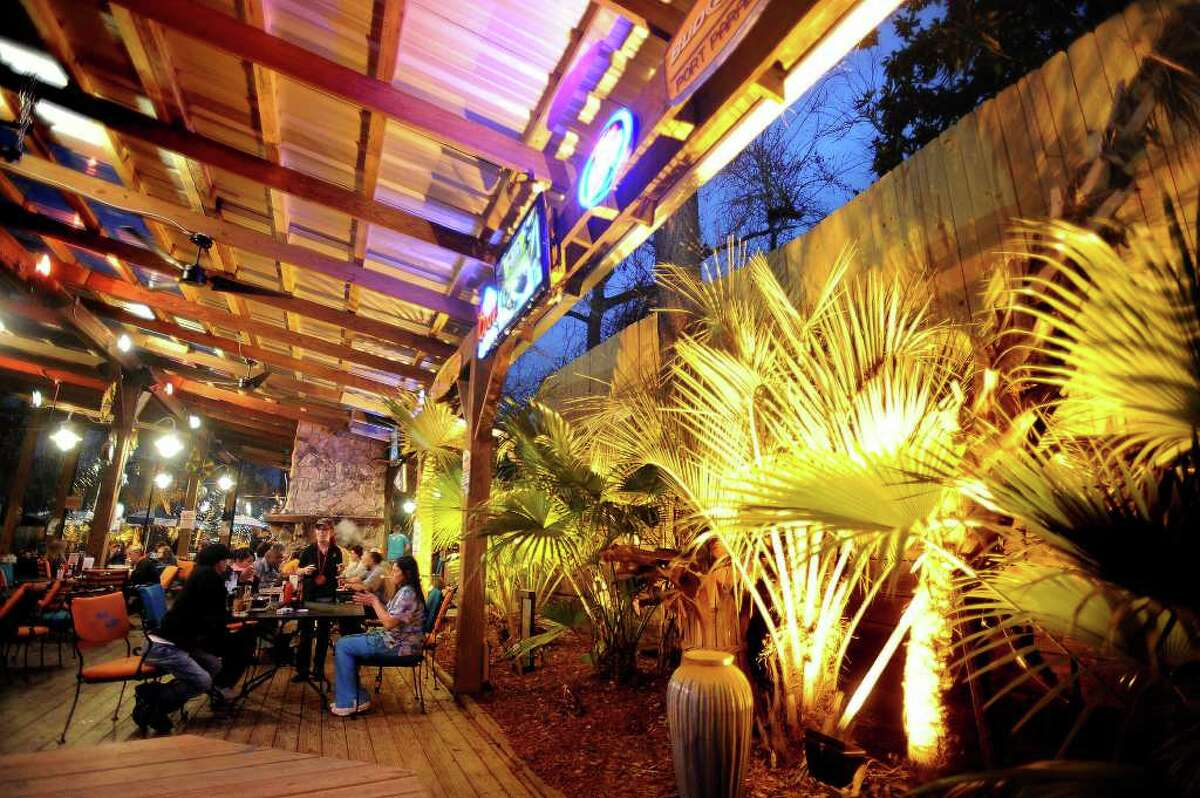 After noise complaints from nearby residents, Starvin Marvin's owners erected a large fence with insulation in it to reduce the sound of their live bands. Guests dine at Starvin Marvin's Monday night. Guiseppe Barranco/The Enterprise
