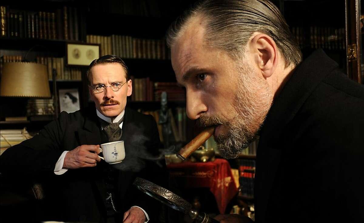 "Michael Fassbender as Carl Jung and Viggo Mortensen as Sigmund Freud in, ""A Dangerous Method."""